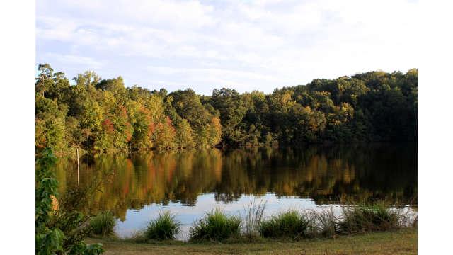 Lake Herrick reflecting the fall colors around it
