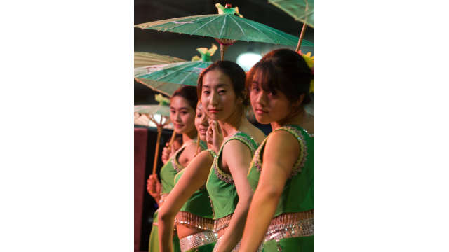 Asian girls performing with umbrellas