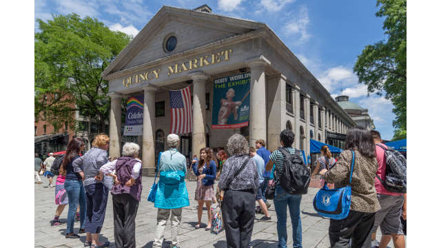 A tour hosted by Boston by Foot makes a stop at Quincy Market