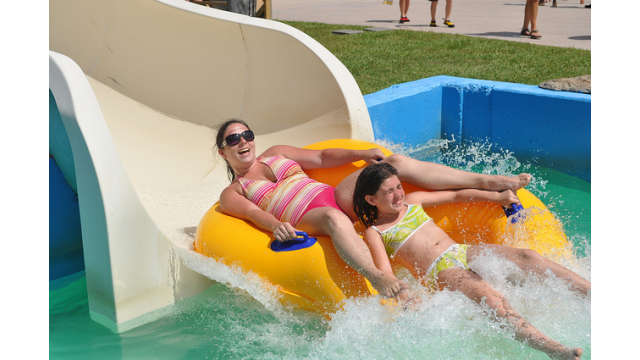 Family tubing down a slide at Gulf Islands Water Park
