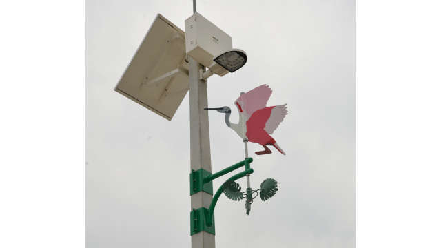 Image of artwork, pink flamingo wind vane