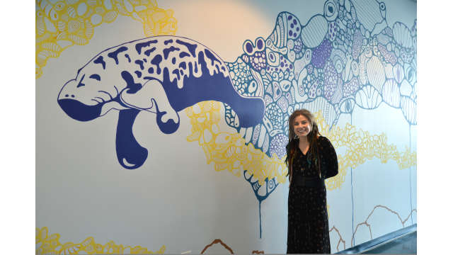 Photo of public artwork, undersea wall mural featuring manatees and turtles