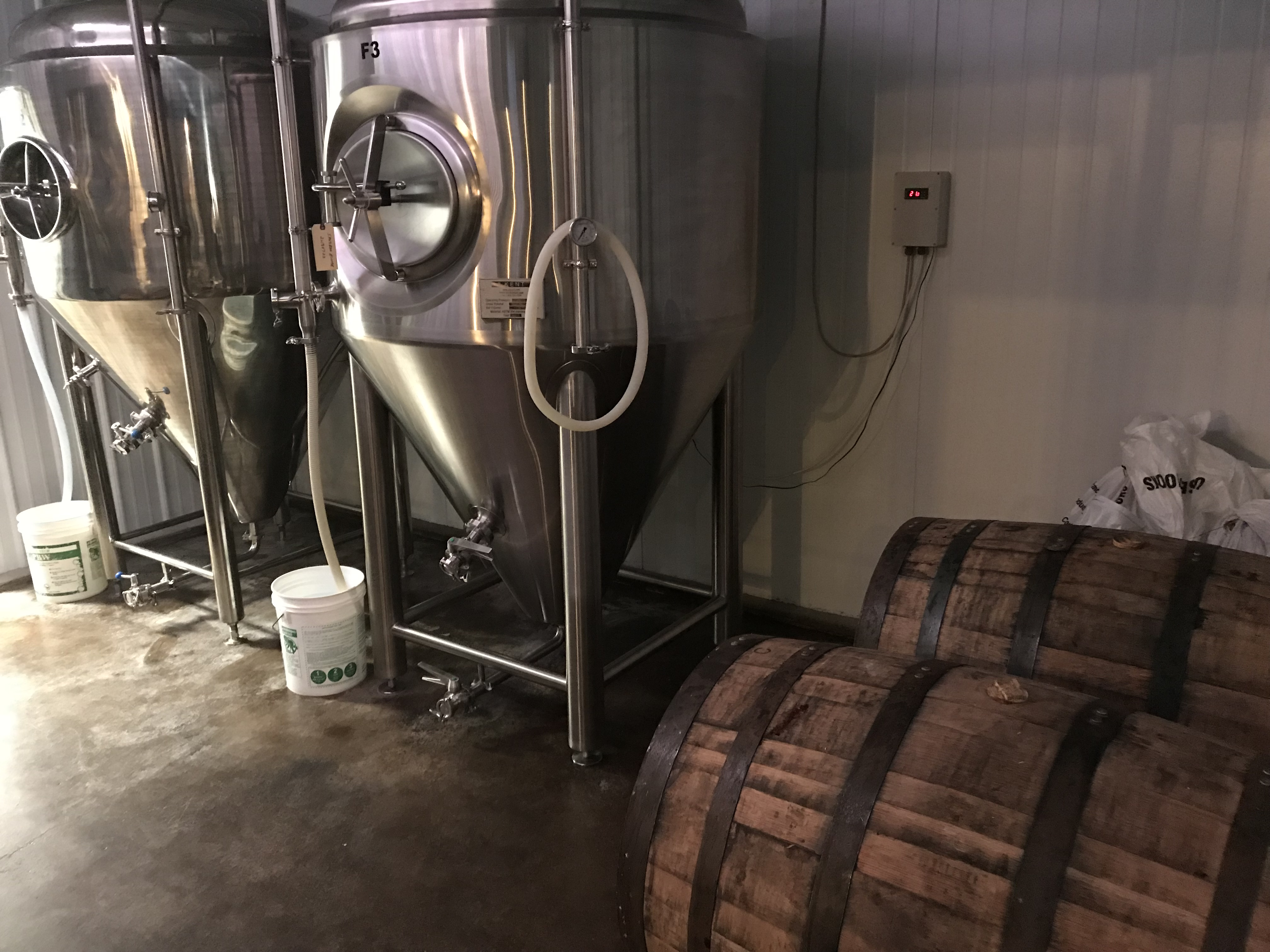 Man Cave Brewing barrels
