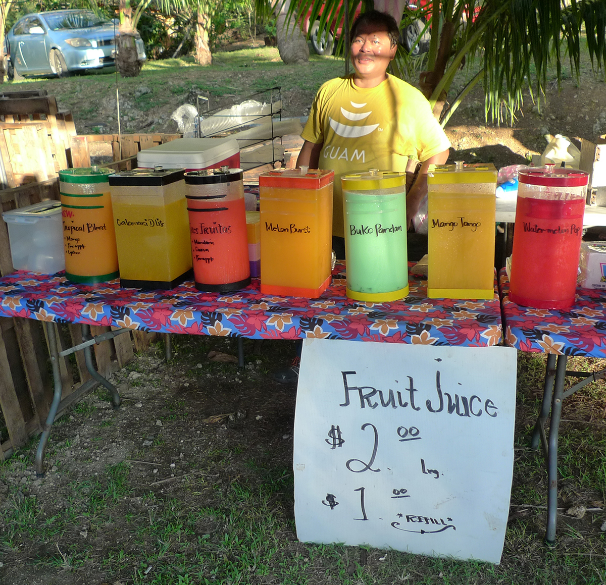 A vendor sells drinks made with local fruit