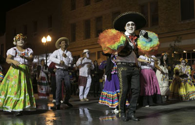 Costumed attendees participate in the Halloween Thriller parade.