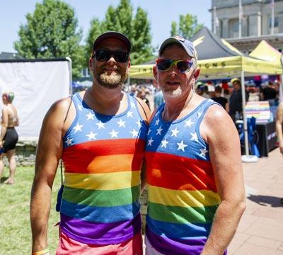 A couple celebrates Pride at the Pride Festival.