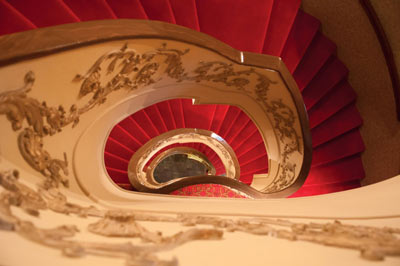 A beautiful staircase leading upstairs in the historic Lexington Opera House.