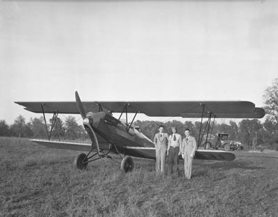 A historic black and white photo of the first plane landing at Halley Field.