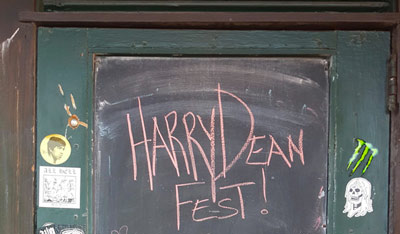 The door at the Green Lantern bar announcing Harry Dean Stanton fest written in chalk.