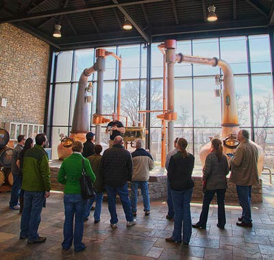 A tour takes place inside the Town Branch Distillery.