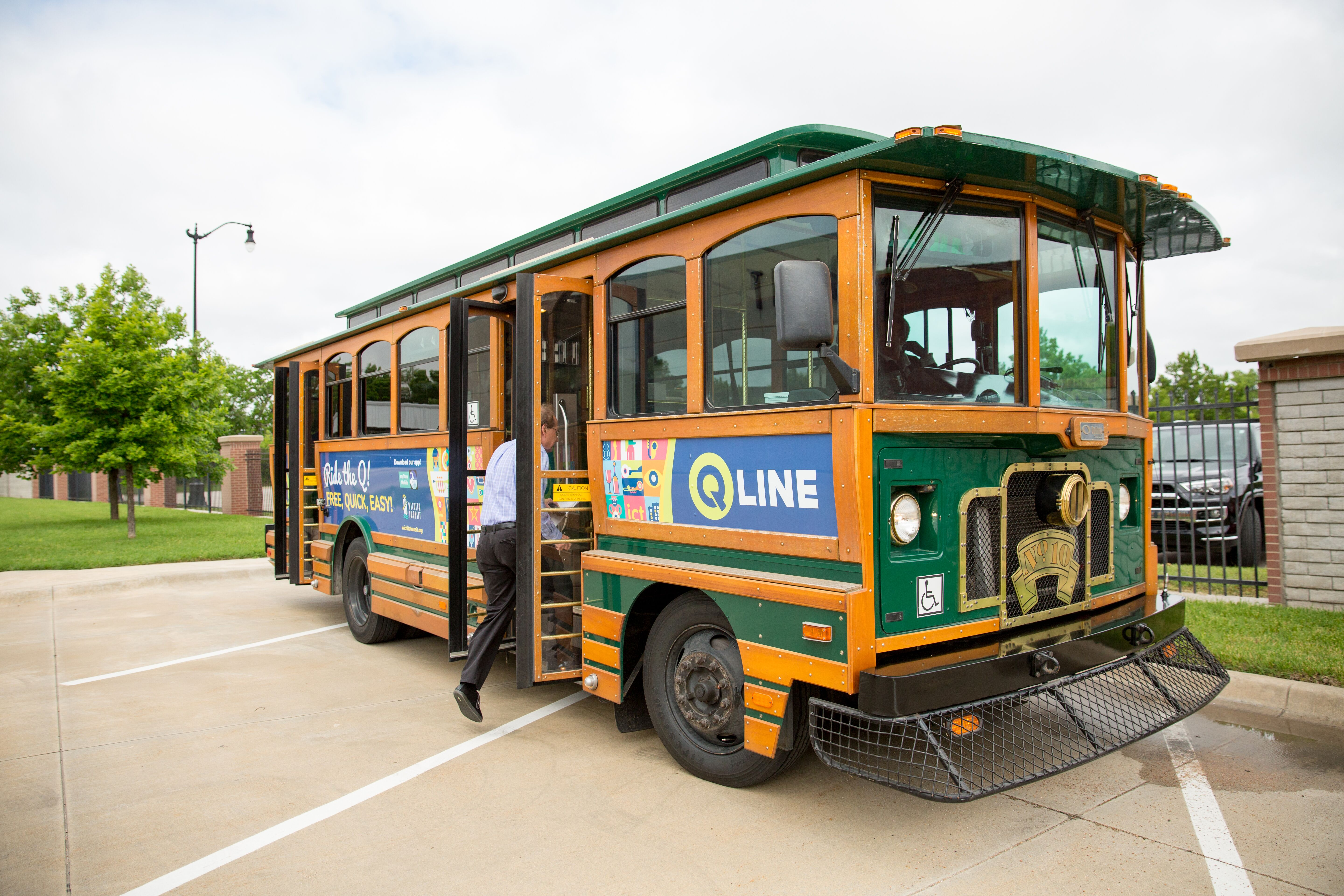 A man boards the Q-Line - a free trolley in Wichita that navigates through downtown